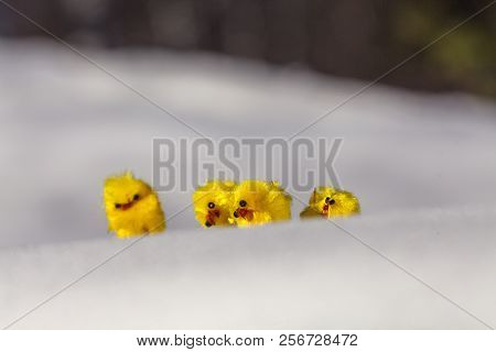 Small, Yellow Aliens Sitting On A Snow Ridge. Visible During The Easter.