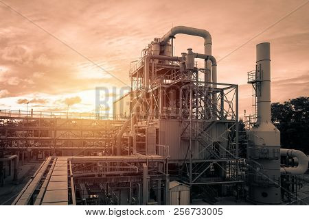 Pipeline And Pipe Rack Of Industrial Plant With Sunset Sky Background, Manufacturing Of Polymer Indu