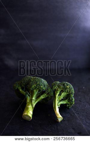 Fresh Brocoli On A Black Matte Background.