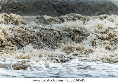 Flood Wave Water Disaster. Rushing Dirty Flood Water Closeup Photo. State Of Emergency.