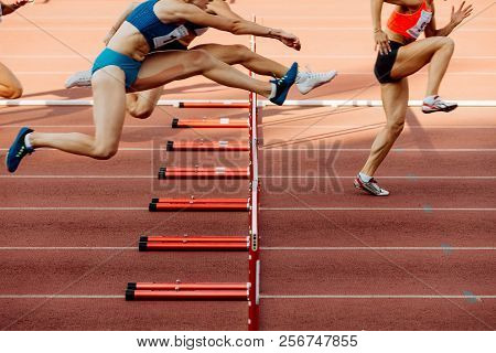athletics women 100 metres hurdles running in stadium poster
