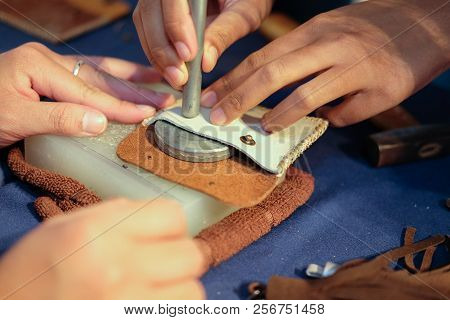 craftsman pinching button on leather bag. handmade DIY handicraft workshop poster