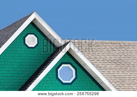 Detail of the typical style of colourful houses in Iles de la Madeleine, or the Magdalen Islands, Canada. Minimalistic style in blue, white and green with space for text.