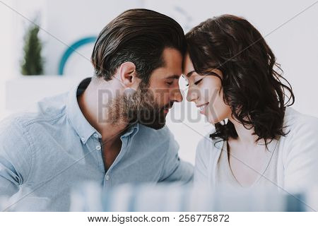 Young Happy Romantic Couple Together At Home. Handsome Bearded Man And Beautiful Smiling Woman Tochi