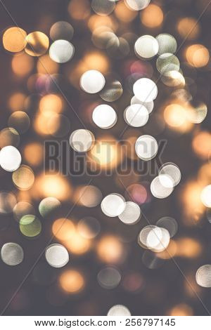 Retro Bokeh Lights On A Dark Background With Glittering Blurs In Various Colors