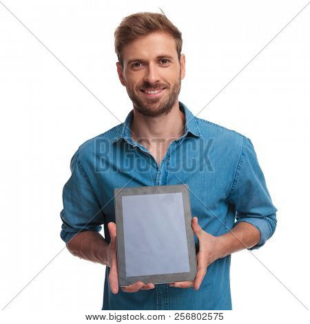 young student showing the screen of his ebook on white background