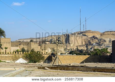 Modern Antennas On A Mound Of Sandstone Desert, Next To The Walls Of The Cairo Citadel. Contrast Bet
