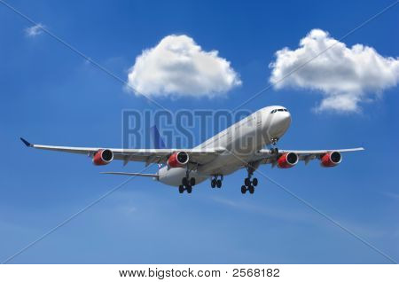 Big Airliner And Clouds