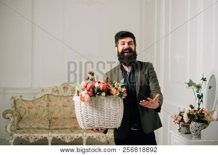 Holiday Concept. Hipster Smile With Holiday Bouquet. Happy Man With Flowers In Basket For Holiday. H