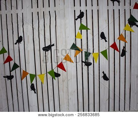 Multicolored Garland. Old Wood Texture Background Surface. Wood Texture Table Surface Top View. Vint