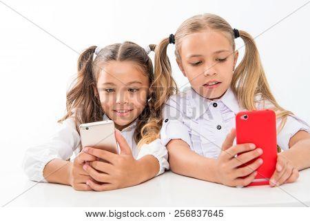 Educational Application. Online Life Concept. Schoolgirls Cute Pupils Use Smartphones Big Diagonal S