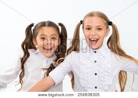 Schoolgirls with cute ponytails hairstyle and brilliant smiles. Best friends excellent pupils. Perfect schoolgirls tidy appearance glad to meet you. Meet new friends in school. Let us get acquainted. poster