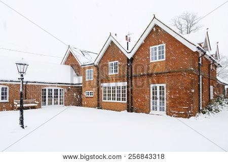 A Traditional Victorian Coach House Covered In Snow In Winter. Buckingham, Uk