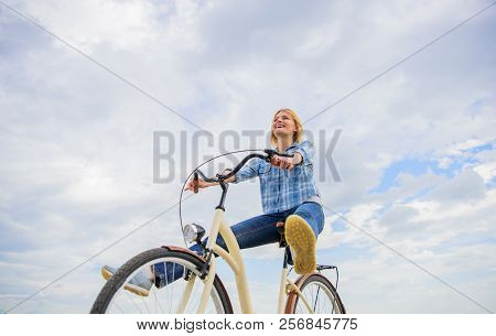 Girl Rides Bicycle Sky Background. Woman Feels Free While Enjoy Cycling. Cycling Gives You Feeling O