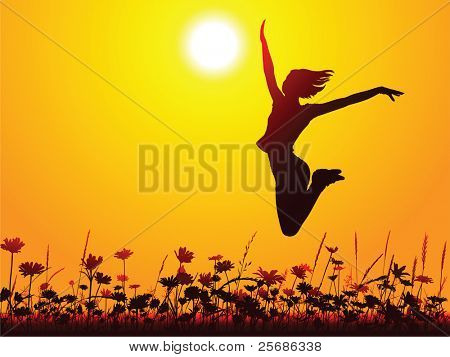 Silhouette of a young girl jumping on the meadow