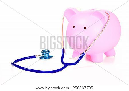 Piggy Bank And Stethoscope Isolated On White Background. Health Care Cost. Financial State Condition