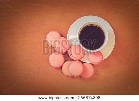 Cup Of Coffee With French Pink Macaroons. Top View With Copy Space.