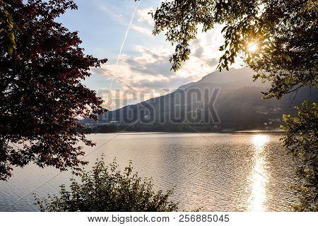 Photo Lake Lago Di Caldonazzo On The Background Of Dolomites In Italy