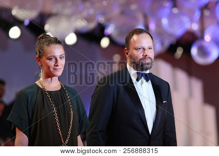 Yorgos Lanthimos and Ariane Labed walk the red carpet ahead of the 'The Favourite' screening during the 75th Venice Film Festival at Sala Grande on August 30, 2018 in Venice, Italy.