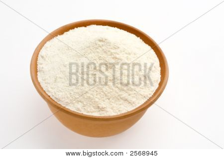 Tortilla Flour In A Terracotta Bowl On A White Background