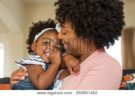 African American Family. Mother And Daughter Smiling At Home.