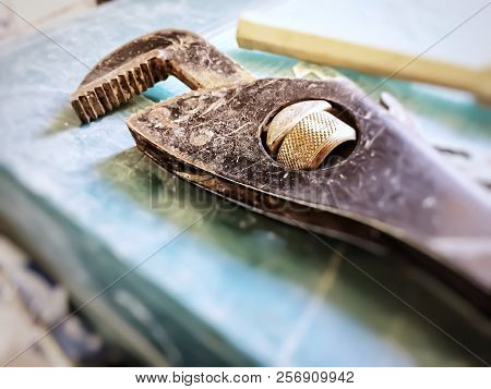 Aged Teethy Wrench. Repairing Work Utensil. Renovation Concept