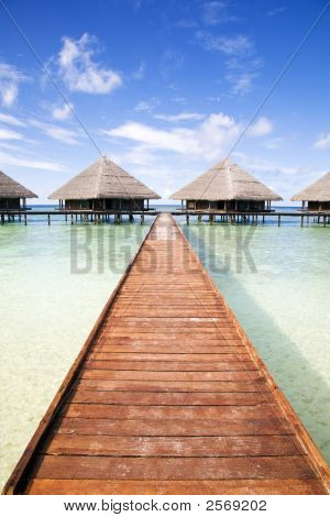 tropical beach: tropical resort and cloudy sky poster