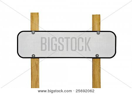 Blank reflective highway message sign on wooden posts.