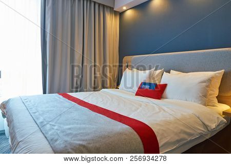 MOSCOW, RUSSIA - CIRCA AUGUST, 2018: interior shot of a hotel room in Holiday Inn Express. Holiday Inn Express is a mid-priced hotel chain within the InterContinental Hotels Group family of brands.