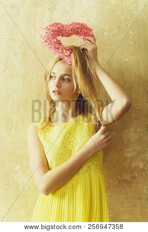 Pretty Girl Or Cute Woman With Blond Hair And Adorable Face In Yellow Dress With Pink Wicker Heart F