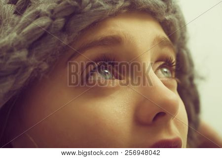 Pretty Girl Or Cute Young Woman With Blond Hair And Adorable Face Looking Up In Fashionable Grey Hat