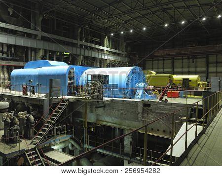 Steam Turbine And Power Generator At An Power Plant, Night Scene