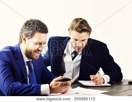 Boss Gives Instructions To Employee. Busy People With Smiling Faces Write Papers. Boss In Formal Sui