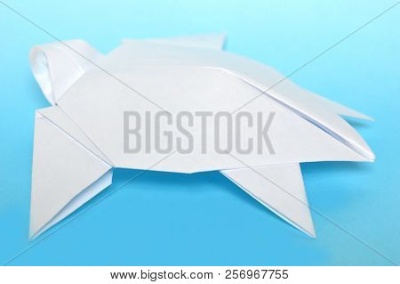 White Origami Sea Turtle On Blue Background