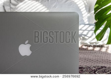 Moscow, Russia - 6 September 2018. Macbook Pro On A Bed In Sunny Day. Mockup For The Decals