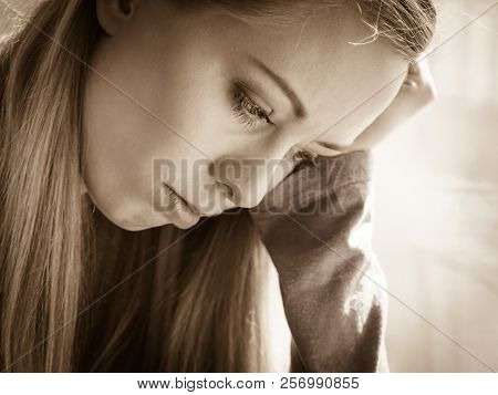 People and solitude concept. Alone sad troubled young woman long hair teen girl lost in thought poster