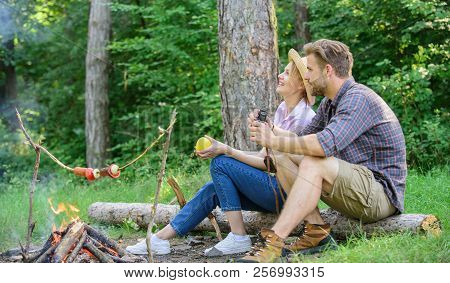 Couple Relaxing Sit On Log Having Snacks. Family Enjoy Romantic Weekend In Nature. Pleasant Picnic O