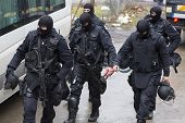 Special law enforcement unit. Special police force units in uniforms, bulletproof vests, firearms and guns. Masked police officers. Special Assault Team during mission. poster