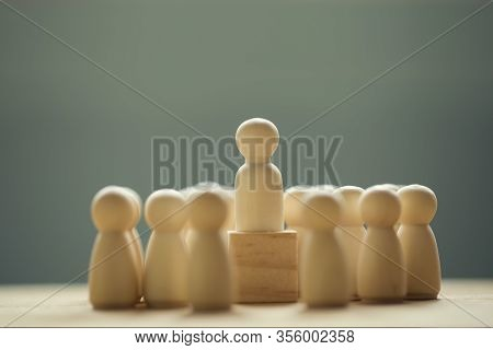 Successful Business Team Leader Concept: Businessman Standing At The Highest Point On Wooden Block S