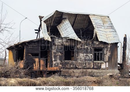 A Sinful House, Arson Incident. Broken Roof And Glass Windows, Charred Walls. Black Rural Cottage Af