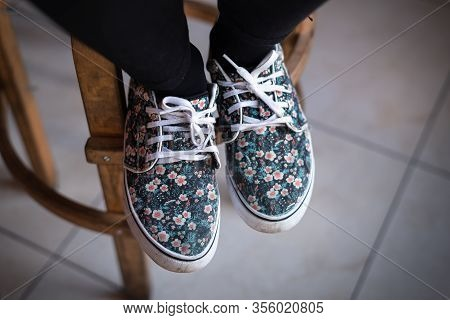 Woman Legs In Sneakers.. Young Woman Legs In Flower Sneakers. Sneakers. Legs In Sneakers. Casual Clo