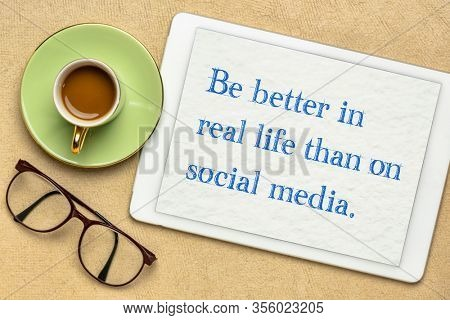 be better in real life than on social media - inspirational reminder on a digital tablet, internet networking concept