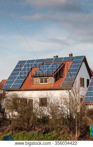 House With A Lot Of Solar Panels On The Roof