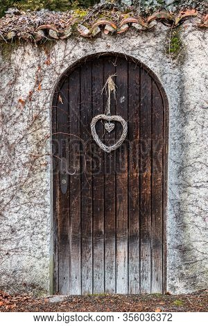 Old Wooden Door In A Long Stone Wall