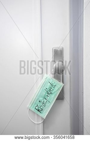 Green Medical Mask On Apartment Door With Text Risk Patient, Coronavirus Concept