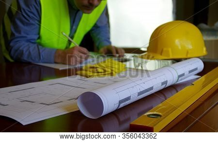 Construction Manager, Contractor, Builder Or Engineer In Workplace. Working Man Over Building Sketch