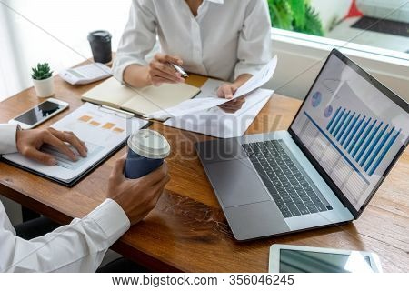 Young Business Team In Casual Style Have Small Meeting