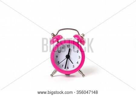 Table Clock Alarm Clock In A Classic Shape. The Case Is Metallic Pink. Background For Those Who Do N