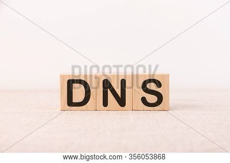 Dns Word Concept Written On A Light Table And Light Background
