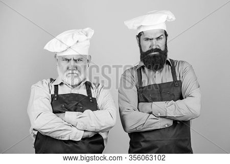 Who Is The Best. Family Dinner. Father And Son Cooking. Commercial Kitchen At Restaurant. Profession